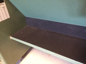 This is rubber mat, attached with carpet tape to protect the cutting edges