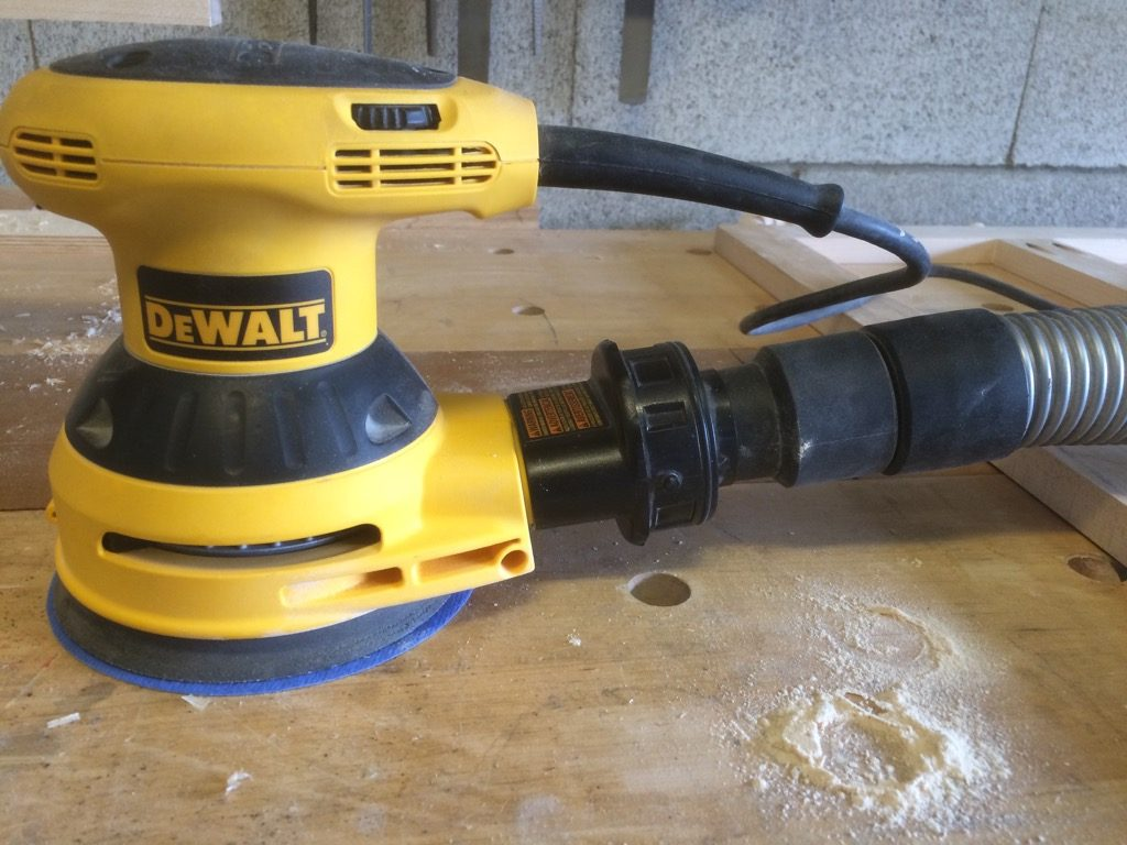 Dewalt random orbit sander with Bosch dust hose connected